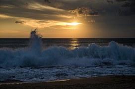 Ocean waves wash onto shore.